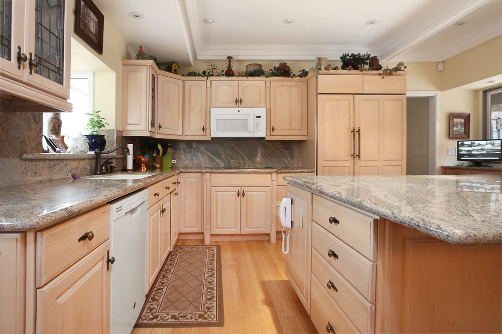 N-Hance woodworking franchise light tan cabinets with gray granite