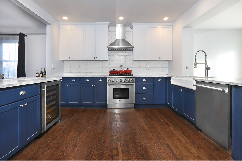 N-Hance refinished kitchen that is blue and white with dark wood floors wood refinishing franchise