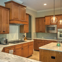 N-Hance refinished kitchen with cedar wood and antique lights