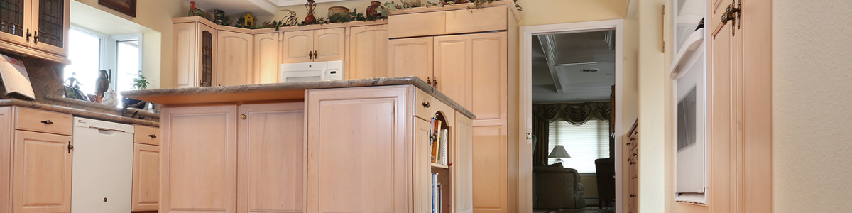 N-Hance refinished kitchen with tan floors anf cabinets
