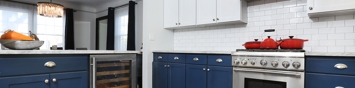 NHance blue and white kitchen with red pots