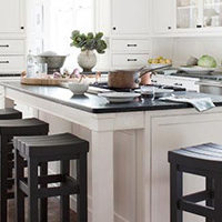 N-Hance refinished black and white kitchen with green accent plants