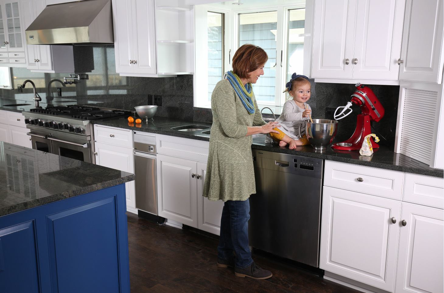 mother and baby in kitchen on counter