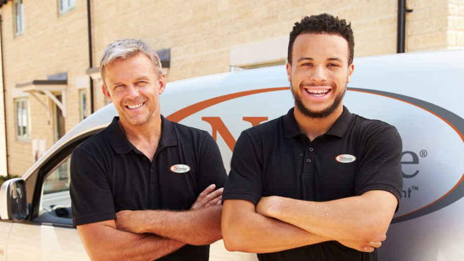 N-Hance franchise owners standing in front of van