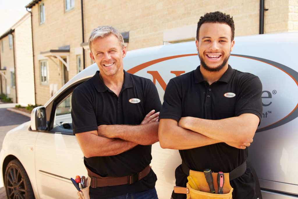 N-Hance franchise two men stand in front of van