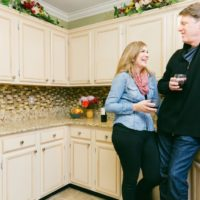 N-Hance wood refinishing franchise happy customers in their remodeled kitchen