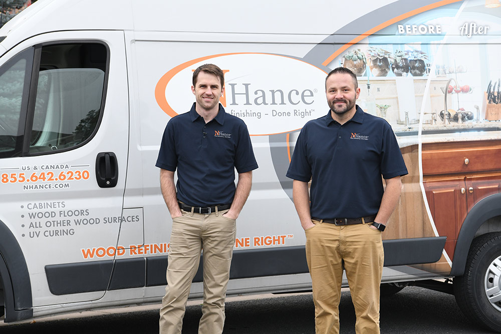 N-Hance wood franchise franchisees stand in front of van