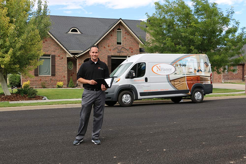 N-Hance franchise owner stands with N-Hance van
